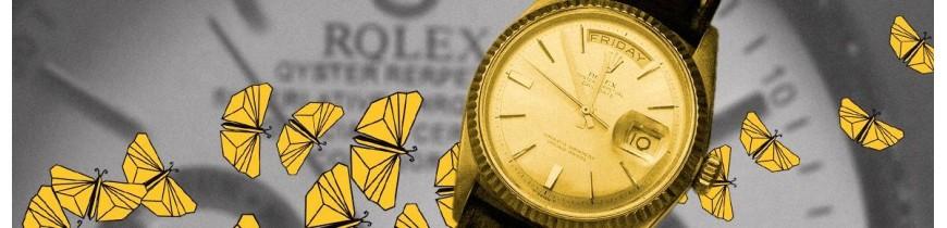 Relojes y plumas